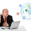 Businessman sitting at desk and looking laptop with globe and so — Stock Photo #23037976