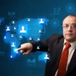 Businessman choosing from social network map — Stock Photo #23038252
