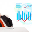 Businessman sitting at desk with statistics and making a phone c — Stock Photo #23038492