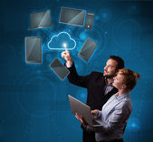 Happy couple touching cloud service — Stock Photo