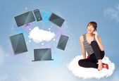 Young girl sitting on cloud enjoying cloud network service — Stock Photo