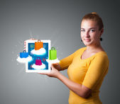 Woman holding modern tablet with colorful shopping bags on cloud — Stock Photo