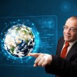 Businessman touching high-tech 3d earth panel - Foto Stock
