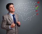Young man choosing between right and wrong sings — Stock Photo