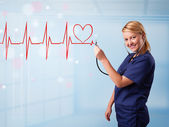 Young nurse listening to abstract pulse with red heart — Stock Photo