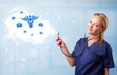 Giovane medico con nuvola astratta e icone mediche — Foto Stock