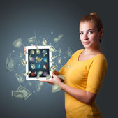 Young woman holding tablet with money — Stock Photo