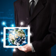 Businessman presenting 3d earth globe in tablet — Stock fotografie