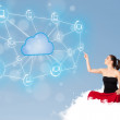 Stock Photo: Happy woman sitting on cloud with cloud computing