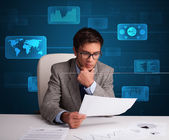 Businessman doing paperwork with digital background — Stock Photo