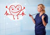 Atrakcyjny lekarz czerwonymi szczęśliwy uśmiechający się serce — Zdjęcie stockowe