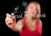 Woman draving social network theme on whiteboard — Stock Photo