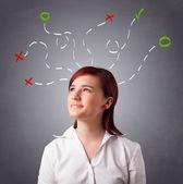 Mujer joven pensando con las marcas abstractas arriba — Foto de Stock