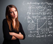 Beautiful school girl thinking about complex mathematical signs — Foto Stock