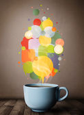 Tea cup with colorful speech bubbles — Stock Photo