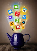 Tea pot with colorful media icons — Stock Photo