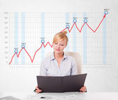 Young businesswoman calculating stock market with rising graph i — Stock Photo