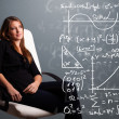 Beautiful school girl thinking about complex mathematical signs - Stock Photo