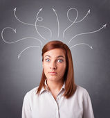 Young girl thinking with arrows overhead — Stock Photo
