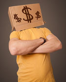 Young man gesturing with a cardboard box on his head with dollar — Stock Photo
