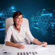 Stock Photo: Businesswoman doing paperwork with futuristic background