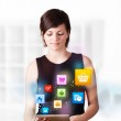 Young woman looking at modern tablet with colourful icons — Stock Photo