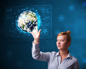 Young buinesswoman touching high-tech 3d earth panel — Stock Photo