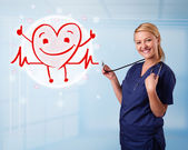 Attractive doctor with happy red smiling heart — Stock Photo