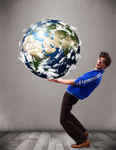 Good-looking man holding 3d planet earth — Stock Photo