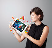 Woman holding modern tablet with colorful diagrams and graphs — Foto Stock