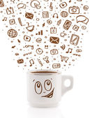 Coffee-mug with hand drawn media icons — Stock Photo