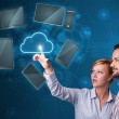 Happy couple touching cloud service — Stock Photo #25149271