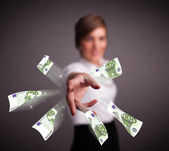 Pretty woman standing and throwing money — Stock Photo