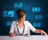 Businesswoman doing paperwork with digital background — Stock Photo