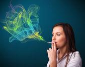 Pretty lady smoking cigarette with colorful smoke — Stock Photo