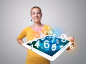 Young woman holding tablet with numbers — Stok fotoğraf