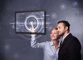 Young couple touching modern technology tablet — Stock Photo