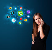 Young woman calling by phone with various icons — Stockfoto