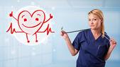 çekici doktor mutlu kırmızı kalp gülümseyen — Stok fotoğraf