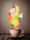 Tekopp med färgglada pratbubblor — Stockfoto