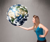Pretty girl holding 3d planet earth — Stock Photo