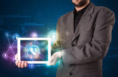 Businessman showing social networking technology with colorful l — Stock Photo
