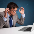 Angry man sitting at desk and typing on laptop — Stock Photo