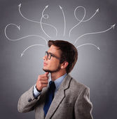 Young man thinking with arrows overhead — Stock Photo