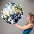 Pretty girl holding 3d planet earth — Foto Stock