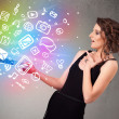 Young lady holding notebook with colorful hand drawn multimedia  — Stock Photo