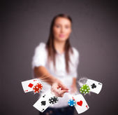 Young woman playing with poker cards and chips — Stock Photo