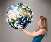 Pretty girl holding 3d planet earth — Stockfoto