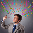Young man thinking wiht colorful abstract lines overhead — Stock Photo