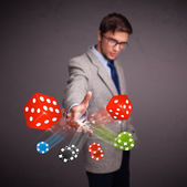 Attractive man throwing dices and chips — Stock Photo